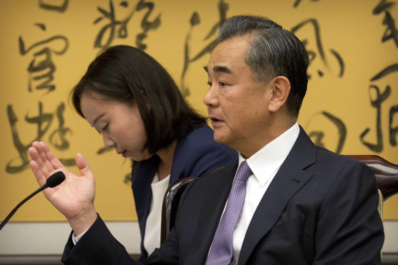 Chinese Foreign Minister Wang Yi, right, speaks during a meeting with Tedros Adhanom Ghebreyesus, director General of the World Health Organization (WHO), at the Ministry of Foreign Affairs in Beijing, Tuesday, July 17, 2018. (AP Photo/Mark Schiefelbein, Pool)