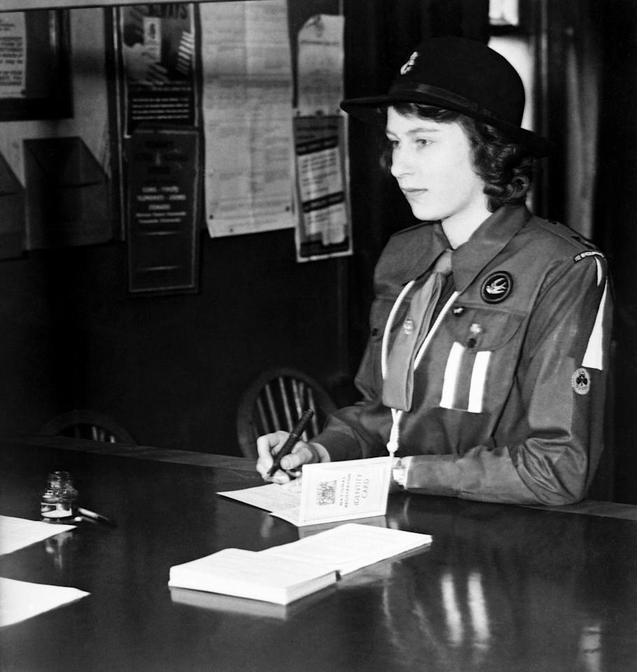 <p>Princess Elizabeth, in her Girl Guide uniform (PA Archive) </p>