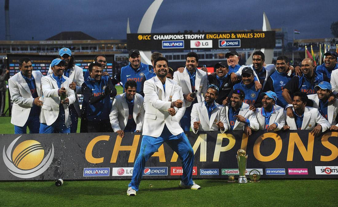 BIRMINGHAM, ENGLAND - JUNE 23:  Virat Kohli of India dances in front of the winners board as the India team celebrate winning the Champions Trophy during the ICC Champions Trophy Final match between England and India at Edgbaston on June 23, 2013 in Birmingham, England.  (Photo by Christopher Lee-ICC/ICC via Getty Images)