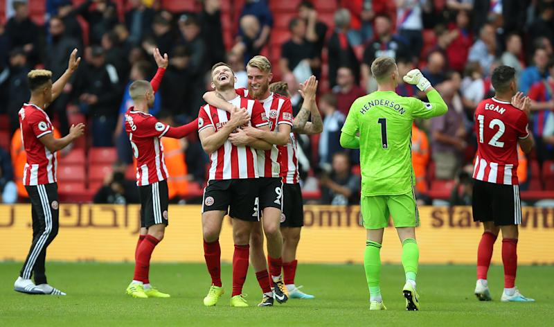 Sheffield United's Jack O'Connell (centre left) and Sheffield United's Oliver McBurnie (centre right) celebrate after the final whistle Sheffield United v Crystal Palace - Premier League - Bramall Lane 18-08-2019 . (Photo by Nigel French/EMPICS/PA Images via Getty Images)