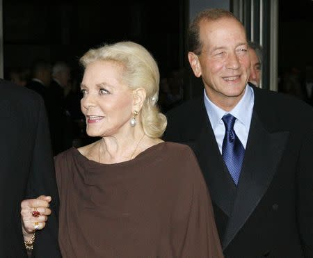 Actress Lauren Bacall arrives with her son Stephen Humphrey Bogart (R) at the Academy of Motion Picture Arts & Sciences 2009 Governor Awards in Hollywood, California, in this file picture taken November 14, 2009. REUTERS/Fred Prouser/Files