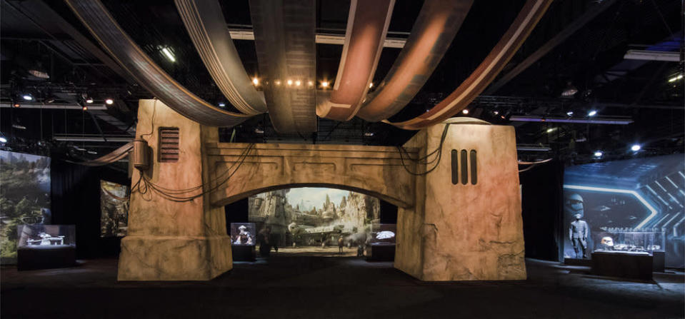 <p>Disney Parks and Resorts erected a massive pavilion at D23 Expo packed with concept art, scale vehicles, costumes, props, and a fully detailed model of Galaxy's Edge. Guests entered the area through an archway, with displays representing the Resistance to the left, the <em>Millennium Falcon</em> hangar in the middle, and the First Order on the right. (Disney Parks/Joshua Sudock) </p>