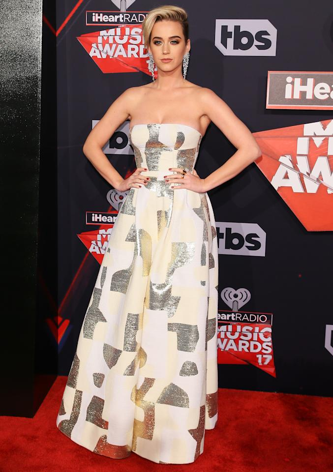 """<p>After hitting the stage to perform, the pop star stepped backstage to <a rel=""""nofollow"""" href=""""http://www.instyle.com/news/katy-perry-breakover-pixie-cut-2017-iheartradio-music-awards"""">chat with host Ryan Seacrest</a> about her career ... and her new pixie cut. """"I think I used to do a lot more like queen of innuendo,"""" Perry told the media mogul. """"And now it's a little bit more diverse queen of subtext maybe or princess ... However you want to label me. I don't care!"""" she added with a laugh. """"But I'm 32 now. I feel great. I'm really accepting of myself and have done a little work in that area. And it's really paying off because I'm having fun and feeling free."""" She continued, """"I feel the most authentic I've ever been.</p>  <p>As for her locks, Perry said she had been thinking about chopping her locks for quite some time. """"I always wanted to do a pixie cut,"""" she added. """"I was literally at the Oscar party and I saw Scarlett Johansson. And I had been going, 'Should I do it? Should I not? I like it. I'm not sure if it would look good with my face?' And I saw Scarlett Johansson. She had the same cut. I was like, 'Dang. That's one of the most beautiful women in the world. I could do that too and look maybe half as good. So I went there.""""</p>"""