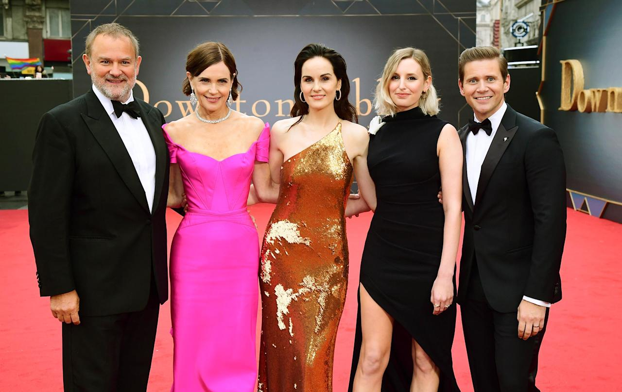 Polish that silver and call the footmen — <em>Downton Abbey </em>is back! While it might not be as monumental as the Queen visiting Downton (ok, so sue us, it's probably a bigger deal!), it is a reason to celebrate. <em>Downton Abbey </em>heralded its return, this time on the big screen (Sept. 20 in the U.S.) with a star-studded London premiere that saw everyone from Mrs. Hughes to Lady Mary donning their finery and strutting their stuff on the red carpet. Click through to see the cast at the London premiere.