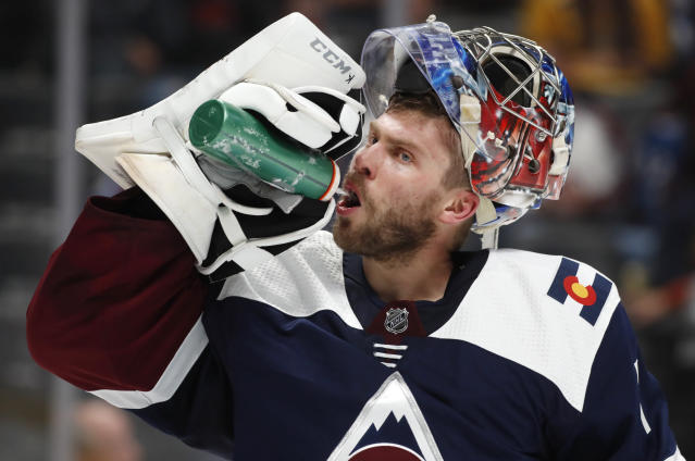 Colorado Avalanche goaltender Semyon Varlamov takes a drink during a break in the second period of the team's NHL hockey game against the Nashville Predators on Wednesday, Nov. 7, 2018, in Denver. (AP Photo/David Zalubowski)