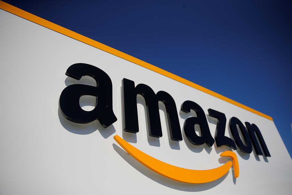 The logo of Amazon is seen at the company logistics center in Lauwin-Planque, northern France, April 22, 2020 after Amazon extended the closure of its French warehouses until April 25 included, following dispute with unions over health protection measures amid the coronavirus disease (COVID-19) outbreak.  REUTERS/Pascal Rossignol