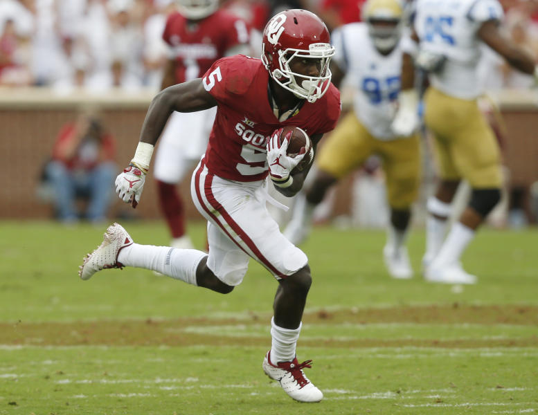 FILE - In this Sept. 8, 2018, file photo, Oklahoma wide receiver Marquise Brown (5) carries during an NCAA college football game against UCLA, in Norman, Okla. Brown is a possible pick in the 2019 NFL Draft. (AP Photo/Sue Ogrocki, File)