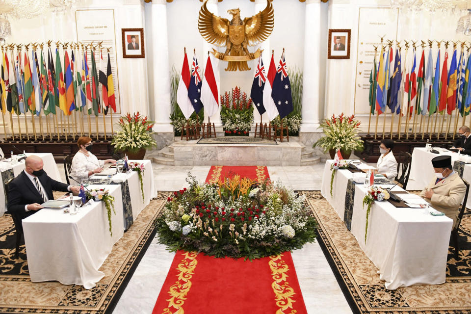 In this photo released by the Indonesian Ministry of Foreign Affairs, Australian Foreign Minister Marise Payne, second left, and Defense Minister Peter Dutton, left, meet with their Indonesian counterpart Retno Marsudi, second right, and Prabowo Subianto, right, during their meeting in Jakarta, Indonesia, Thursday, Sept. 9, 2021. Australia's foreign and defense ministers are visiting Indonesia, India, South Korea and the United States to bolster economic and security relationships within the Asia-Pacific region, where tensions are rising with China. (Indonesian Ministry of Foreign Affairs via AP)