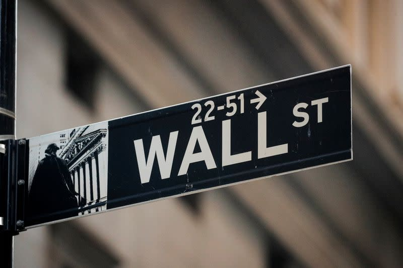 FILE PHOTO: A Wall St. sign is seen near the NYSE in the financial district in New York