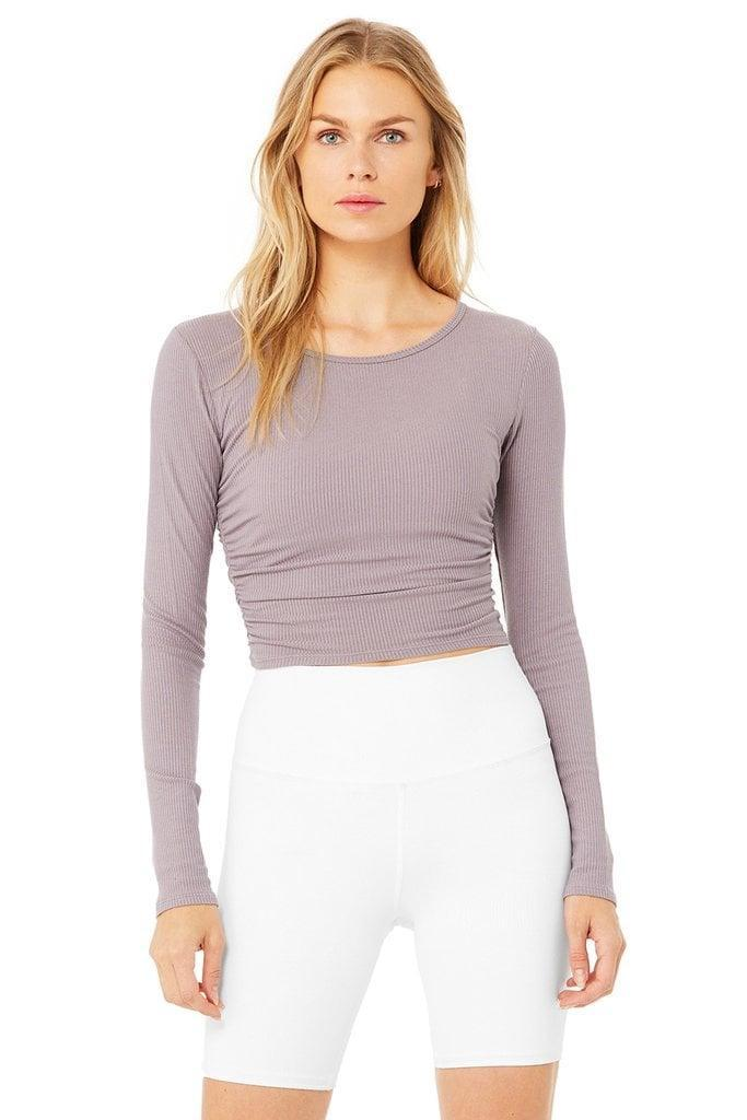 <p>The <span>Alo Yoga Gather Long-Sleeve Top</span> ($58) features pretty cinched detailing on the sides, while the cropped cut will go perfectly with your favorite high-waisted leggings, too.</p>