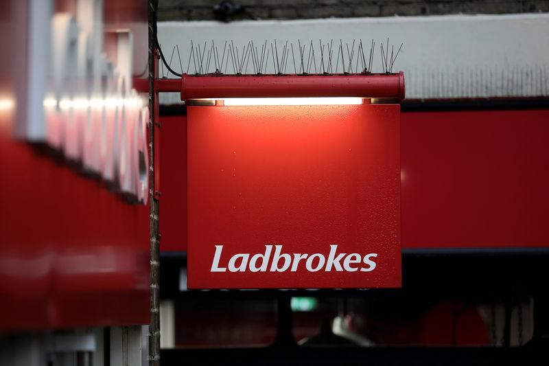 A sign hangs outside a branch of Ladbrokes in London