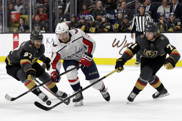 Vegas Golden Knights left wing Max Pacioretty (67) and center William Karlsson (71) defend as Washington Capitals defenseman Nick Jensen skates during the first period of an NHL hockey game Monday, Feb. 17, 2020, in Las Vegas. (AP Photo/Isaac Brekken)