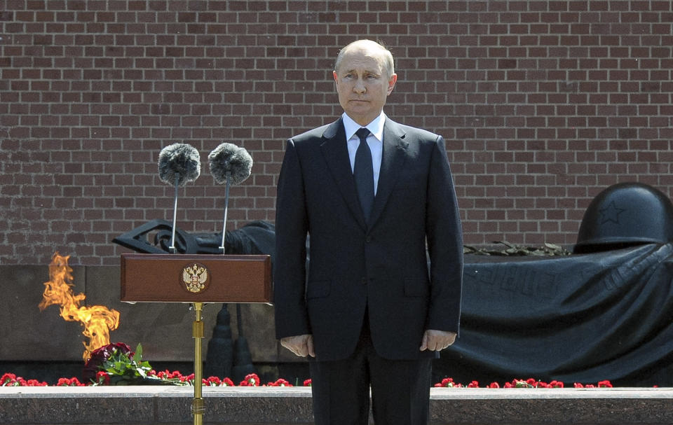 Russian President Vladimir Putin pauses as he delivers his speech standing next to a small group of Russian WWII veterans, during a wreath laying ceremony at the Tomb of Unknown Soldier in Moscow, Russia, Tuesday, June 22, 2021, marking the 80th anniversary of the Nazi invasion of the Soviet Union. (Alexei Nikolsky, Sputnik, Kremlin Pool Photo via AP)