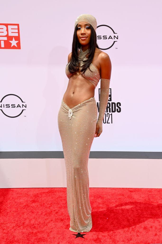 Sevyn Streeter attends the BET Awards 2021 in a floor-length two-piece gown and matching bandanna