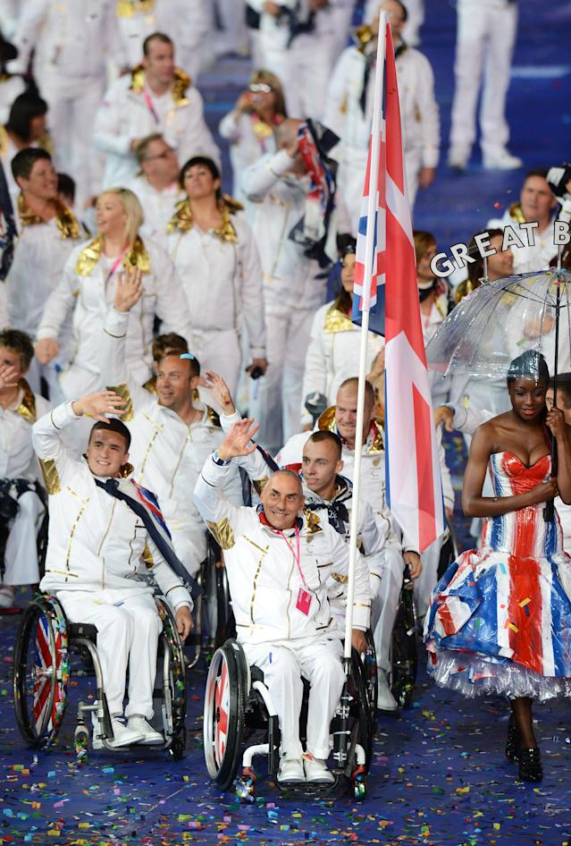 LONDON, ENGLAND - AUGUST 29: Wheelchair tennis player Peter Norfolk of Great Britain carries the flag during the Opening Ceremony of the London 2012 Paralympics at the Olympic Stadium on August 29, 2012 in London, England. (Photo by Gareth Copley/Getty Images)