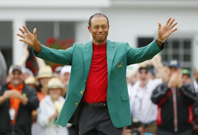 """<h1 class=""""title"""">The Masters - Final Round</h1> <div class=""""caption""""> AUGUSTA, GEORGIA - APRIL 14: Tiger Woods of the United States reacts after being awarded the Green Jacket during the Green Jacket Ceremony after winning the Masters at Augusta National Golf Club on April 14, 2019 in Augusta, Georgia. (Photo by Kevin C. Cox/Getty Images) </div> <cite class=""""credit"""">Kevin C. Cox</cite>"""