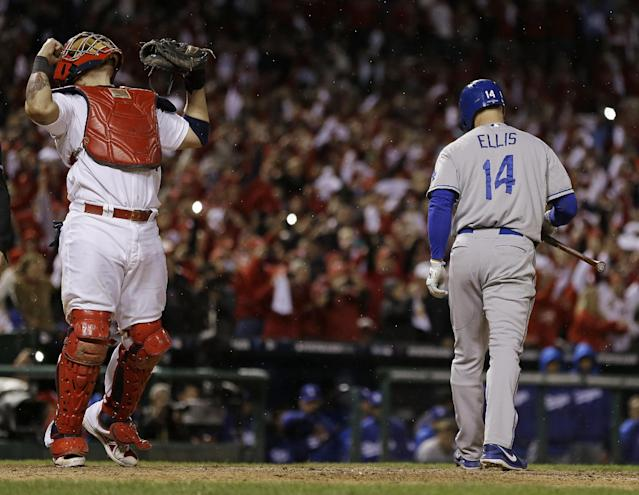 St. Louis Cardinals catcher Yadier Molina reacts after Los Angeles Dodgers' Mark Ellis strikes out to end Game 6 of the National League baseball championship series Friday, Oct. 18, 2013, in St. Louis. The Cardinals won 9-0 to win the series. (AP Photo/Jeff Roberson)