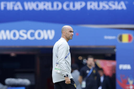 Belgium coach Roberto Martinez arrives to Belgium's official training ahead of the group G match between Belgium and Tunisia at the 2018 soccer World Cup in the Spartak Stadium in Moscow, Russia, Friday, June 22, 2018. (AP Photo/Hassan Ammar)