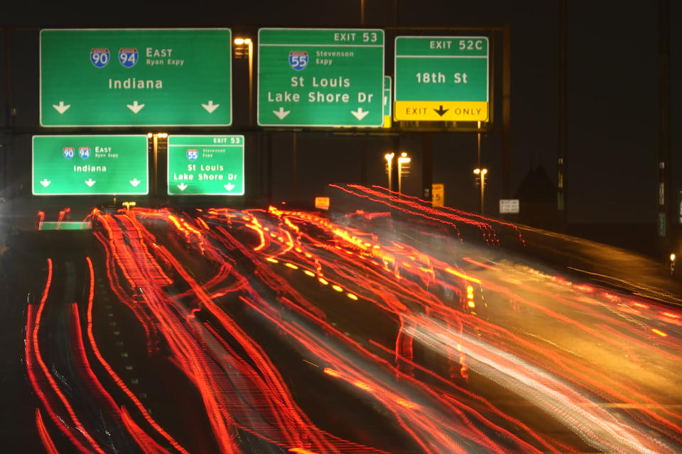 FILE - In this Nov. 24, 2020, file photo, motorists travel south along Interstates 90 and 94 in Chicago. Data from roadways and airports shows millions could not resist the urge to gather on Thanksgiving, even during a pandemic.(AP Photo/Charles Rex Arbogast, File)