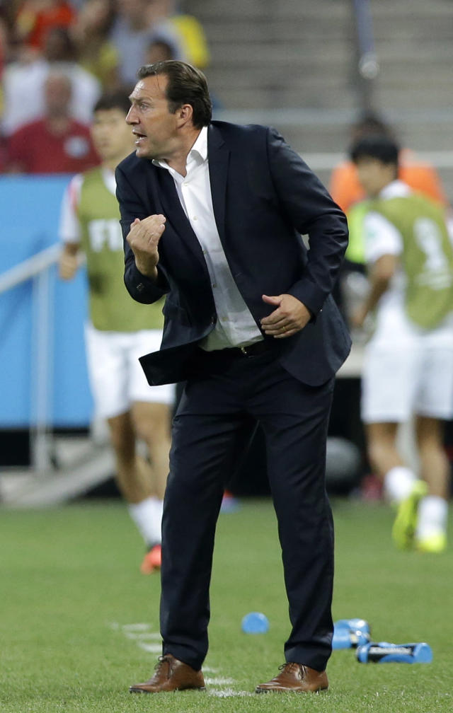 Belgium's head coach Marc Wilmots directs his players during the group H World Cup soccer match between South Korea and Belgium at the Itaquerao Stadium in Sao Paulo, Brazil, Thursday, June 26, 2014. (AP Photo/Lee Jin-man)