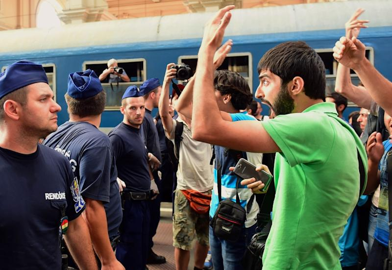 Migrants protest at Keleti railway station in Budapest on September 1, 2015 during its evacuation by local police (AFP Photo/Attila Kisbedenek)