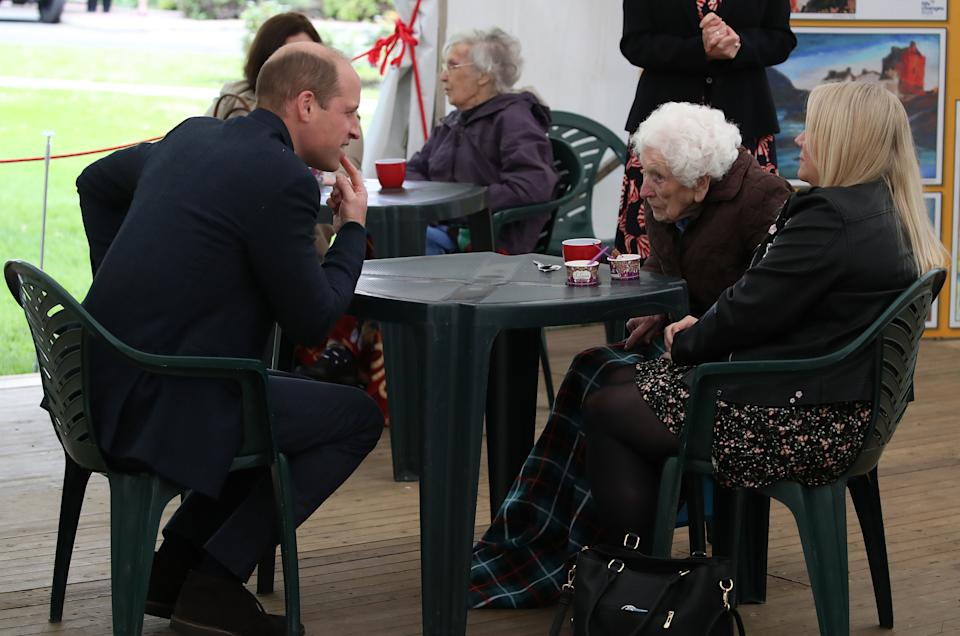 EDINBURGH, SCOTLAND - MAY 23: Prince William, Duke of Cambridge chats to resident Betty Magee (96) and her granddaughter Kimberley Anderson during a visit to the Queens Bay Lodge Care Home, that is run by the Church of Scotland through Cross Reach, to meet with staff, residents and families to hear about the impact of COVID-19 on the home on May 23, 2021 in Edinburgh, Scotland. (Photo by Andrew Milligan - WPA Pool/Getty Images)