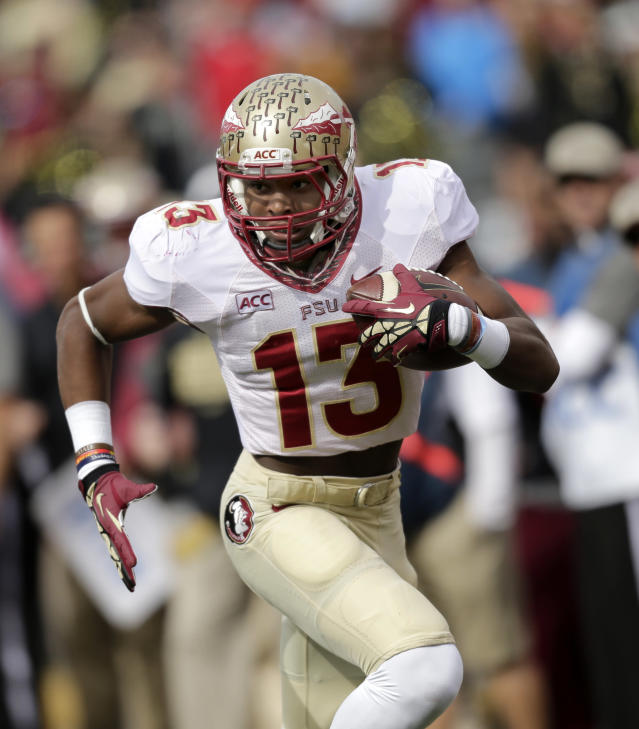Florida State defensive back Jalen Ramsey runs back an interception for a touchdown against Wake Forest in the first half of an NCAA college football game in Winston-Salem, N.C., Saturday, Nov. 9, 2013. (AP Photo/Nell Redmond)