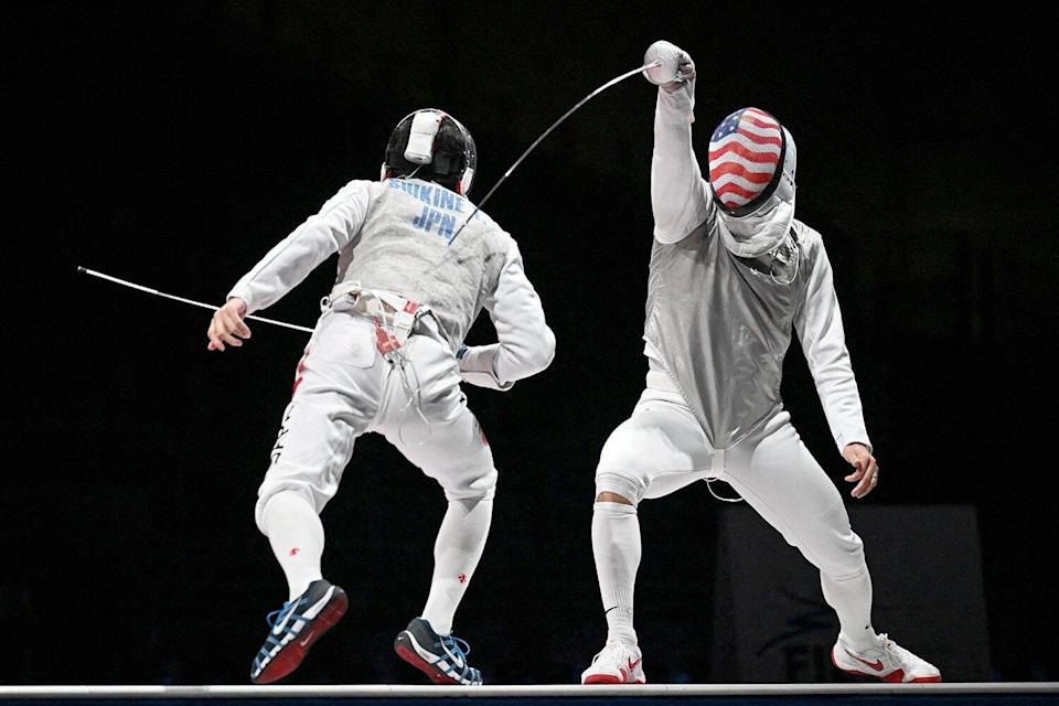 Japan's Takahiro Shikine (L) compete against USA's Gerek Meinhardt in the mens team foil bronze medal bout during the Tokyo 2020 Olympic Games at the Makuhari Messe Hall in Chiba City, Chiba Prefecture, Japan, on August 1, 2021.