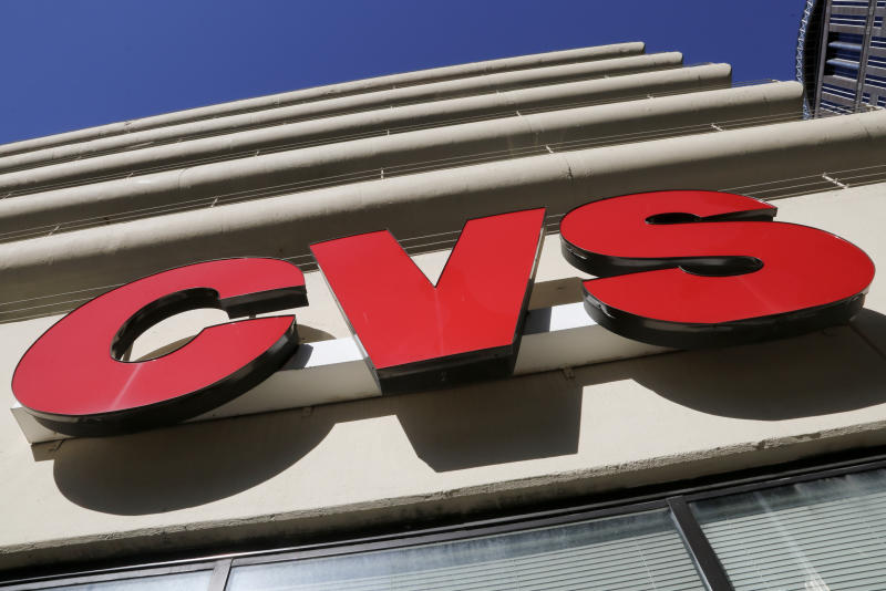 FILE - This Friday, Jan. 26, 2018, file photo shows a sign at a CVS Pharmacy in Pittsburgh. Drugstore chains Walgreens and CVS Health say they will stop locking up beauty and hair care products aimed at black women and other women of color. (AP Photo/Gene J. Puskar, File)