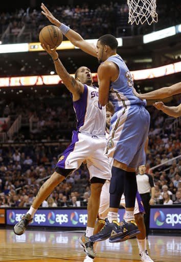 Phoenix Suns' Michael Beasley shoots under Denver Nuggets' JaVale McGee, right, during the second half of an NBA basketball game, Monday, March 11, 2013, in Phoenix. (AP Photo/Matt York)