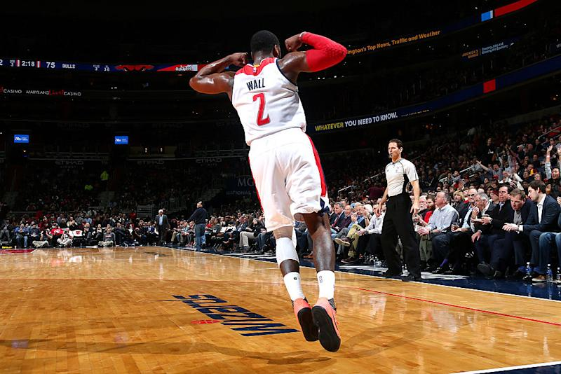 John Wall flexed his muscles when the Wizards needed him most to knock off the Bulls. (Ned Dishman/NBAE/Getty Images)