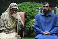 Sumera Bibi, (L) and Manzoor Hussain, sister and brother of Shafqat Hussain who was convicted of killing a child in 2004, react while speaking to Reuters in Islamabad August 3, 2015. REUTERS/Faisal Mahmood