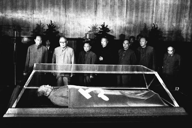 FILE - In this Sept. 10, 1977 file photo, the body of Mao Zedong is on display as Chairman Hua Kuo-feng, Vice Chairman Yeh Chien-ying, Teng H Siao-ping, Hsien-nien and Wang Tung-hsing look on at an unknown location in China. The man commonly known as Chairman Mao is one of several world leaders whose bodies have been preserved and put on perpetual display, as Venezuela's government plans to do with Hugo Chavez. (AP Photo, File)