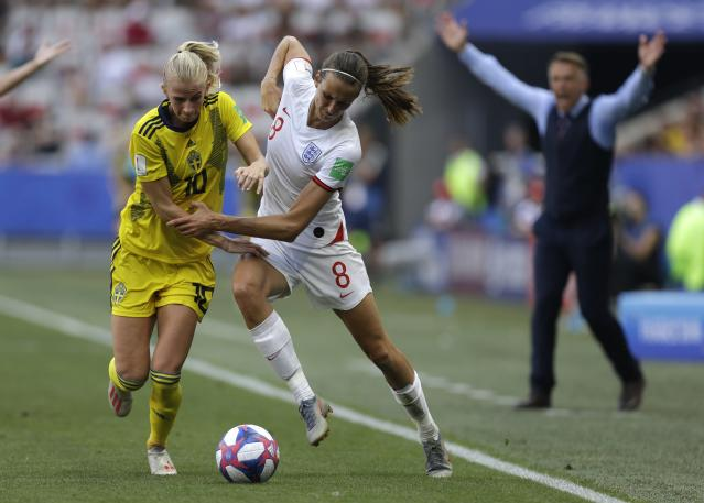 Sweden's Sofia Jakobsson, left, does battle with England's Jill Scott during Saturday's third-place match at the Women's World Cup. (Associated Press)