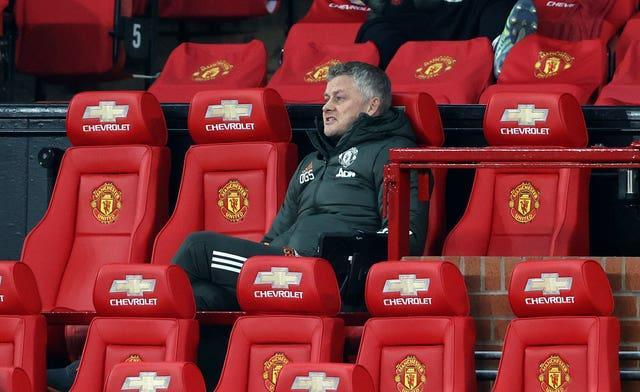 Ole Gunnar Solskjaer sits in the Chevrolet-covered Old Trafford dugout