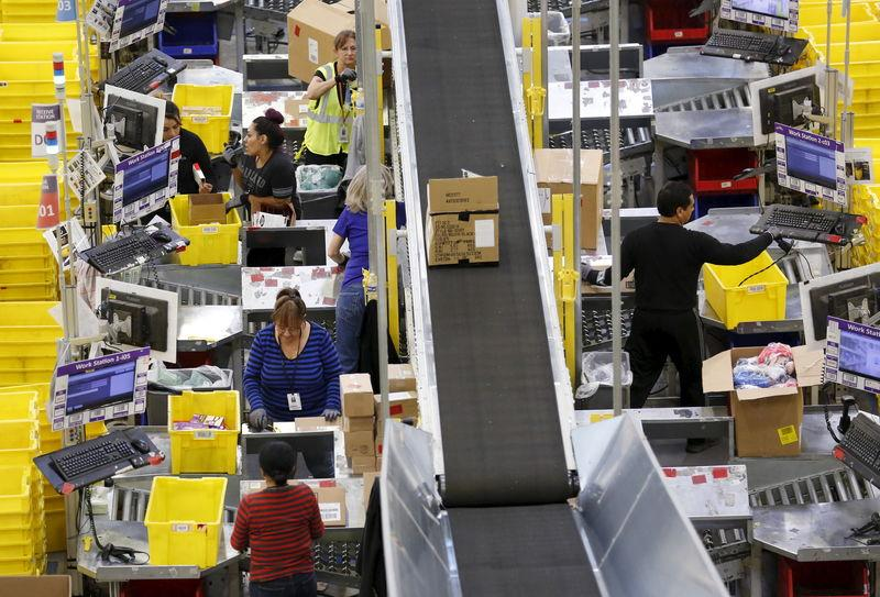 Workers prepare orders at the Amazon Fulfillment Center in Tracy
