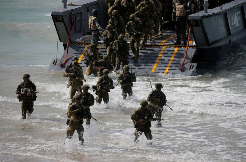 FILE PHOTO: Soldiers from the Australian Army's 3rd Brigade step onto Langham Beach after an amphibious assault landing during the Talisman Saber joint military exercises