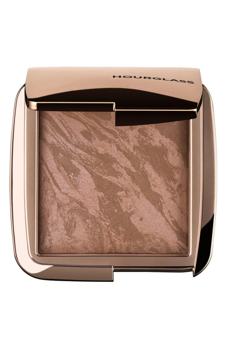 <p>Besides having the most gorgeous packaging, this <span>Hourglass Ambient Lighting Bronzer</span> ($52) will give you a serious sun-kissed glow.</p>