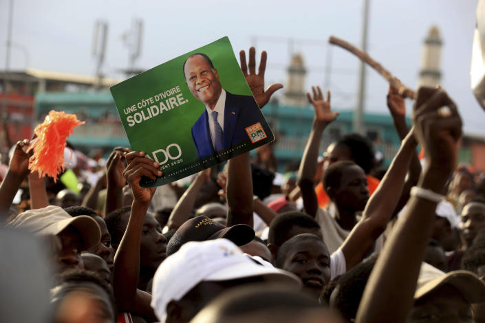 Supporters of President Alassane Ouattara cheers during his last rally in Abidjan, Ivory Coast, Thursday Oct. 29, 2020. Ouattara, who first came to power after the 2010 disputed election whose aftermath left more than 3,000 people dead, is now seeking a third term in office. Opposition candidate Henri Konan Bedie called for a boycott of the Oct. 31 election, complaining that the country's electoral commission is made up entirely of officials from the ruling party.(AP Photo/Diomande Ble Blonde)