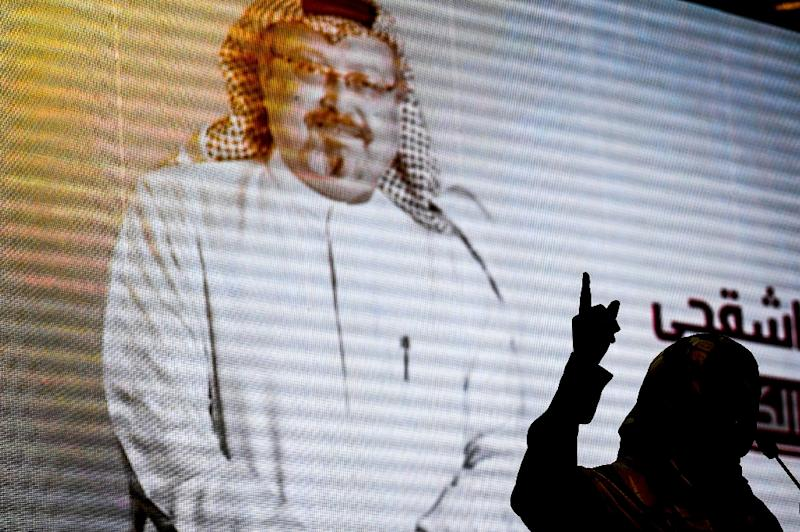 A digital image of Jamal Khashoggi is projected at a commemorative event for the murdered Saudi journalist
