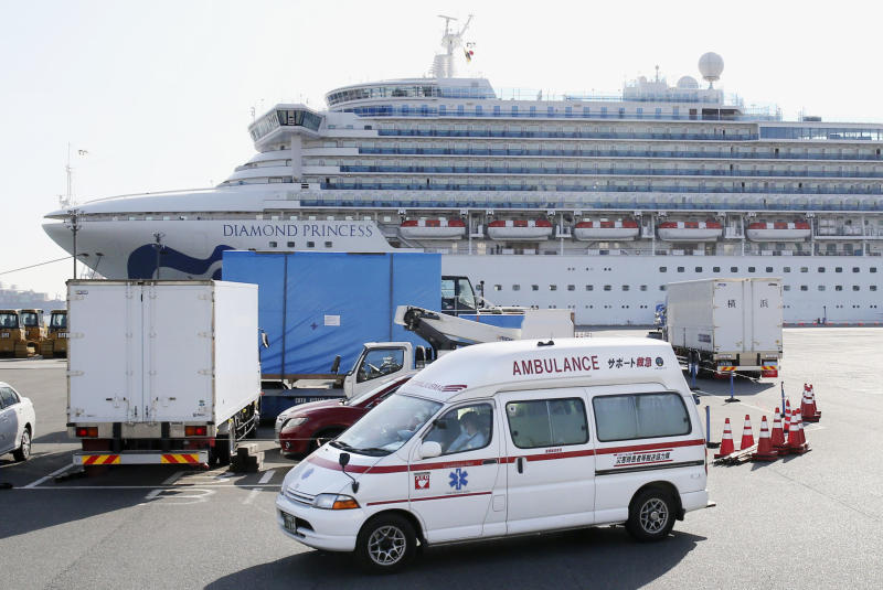 An ambulance leaves Yokohama Port in Japan on February 24. Source: AP