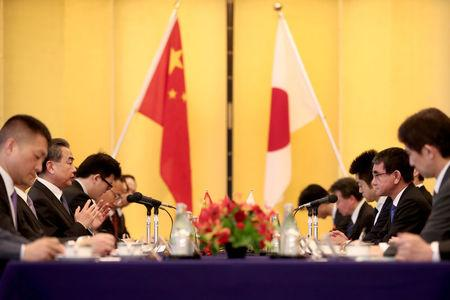 Chinese State Councilor and Foreign Minister Wang Yi (2nd L) and Japan's Foreign Minister Taro Kono (2nd R) meet in Tokyo, Japan April 15, 2018. Behrouz Mehri/Pool via Reuters