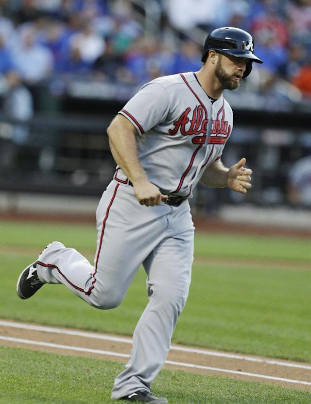 Atlanta Braves' Evan Gattis runs the bases after hitting a home run during the second inning of a baseball game against the New York Mets, Wednesday, July 24, 2013, in New York. (AP Photo/Frank Franklin II)