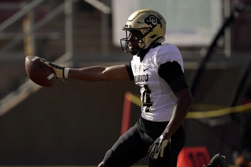 Colorado wide receiver Dimitri Stanley (14) reacts after scoring against Stanford during the first half of an NCAA college football game in Stanford, Calif., Saturday, Nov. 14, 2020. (AP Photo/Jeff Chiu)