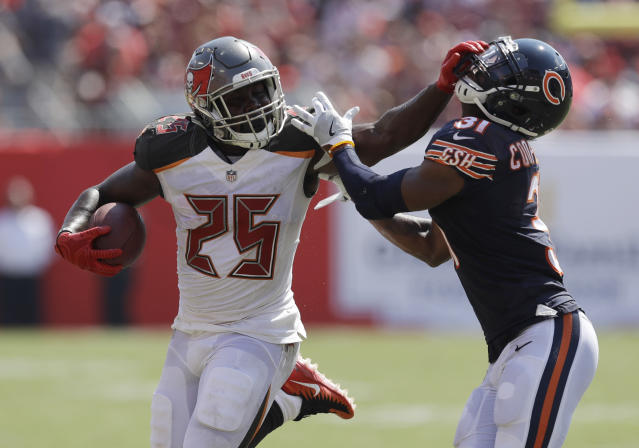 <p>Chicago Bears defensive back Marcus Cooper (31) attempts to stop Tampa Bay Buccaneers running back Peyton Barber (25), during the second half of an NFL football game, Sunday, Sept. 17, 2017, in Tampa, Fla. (AP Photo/Chris O'Meara) </p>