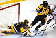 Washington Capitals' Carl Hagelin (62) can't get his stick on a rebound off Pittsburgh Penguins goaltender Casey DeSmith (1) with Penguins' Kris Letang (58) defending during the first period of an NHL hockey game in Pittsburgh, Tuesday, Jan. 19, 2021. (AP Photo/Gene J. Puskar)