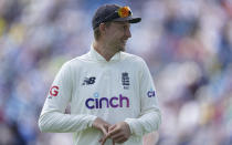 England captain Joe Root smiles during the presentation ceremony after their win on the fourth day of third test cricket match between England and India, at Headingley cricket ground in Leeds, England, Saturday, Aug. 28, 2021. (AP Photo/Jon Super)
