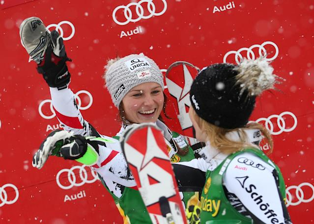 Third placed Bernadette Schild of Austria, left, jokes with her sister Marlies Schild, second placed, on the podium of an alpine skiing women's Slalom in Kranjska Gora, Slovenia, Sunday, Feb. 2, 2014. (AP Photo/Giovanni Auletta)