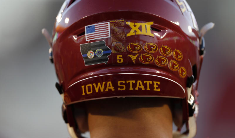 Iowa State wide receiver Allen Lazard wears a decal on his helmet honoring two Des Moines-area police officers that were killed early Wednesday morning before an NCAA college football game against Oklahoma, Thursday, Nov. 3, 2016, in Ames, Iowa. (AP Photo/Charlie Neibergall)