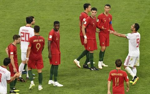 Portugal's forward Cristiano Ronaldo and other players argue during the Russia 2018 World Cup Group B football match between Iran and Portugal at the Mordovia Arena in Saransk on June 25, 2018 - Credit: AFP